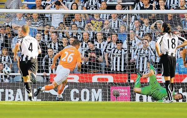 ON TARGET: Charlie Adam scores Blackpool's first goal of the game from the penalty spot against Newcastle United on Saturday