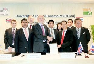 SEALED Dr Malcolm McVicar, vice-chancellor and president of UCLan shakes hands with Mr Sittichicai Charoenkajonkul, CEO Best Group, watched by British and Thai delegates