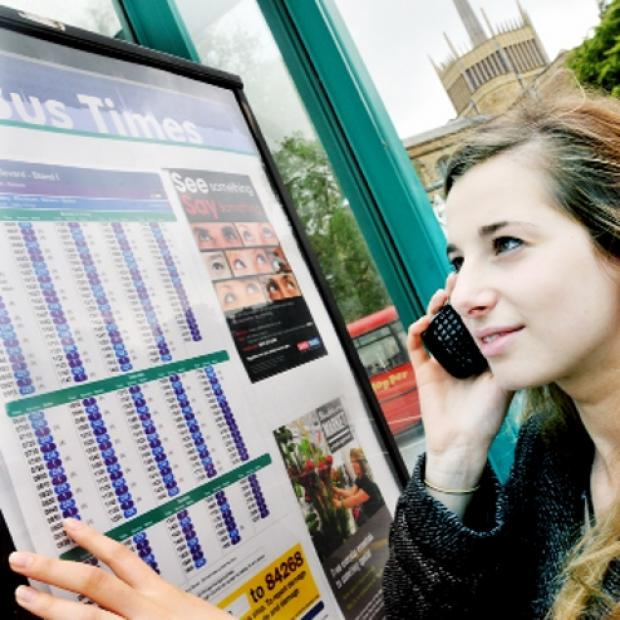 Blackpool Citizen: IN PRINT Passenger Jenny Swerdlow checks the times on Blackburn Boulevard