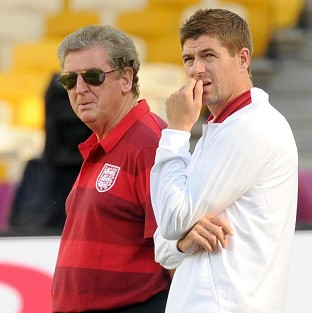 Steven Gerrard (right) and manager Roy Hodgson view the stadium prior to their quarter-final clash
