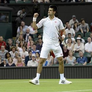 Novak Djokovic claimed a straight sets win over Ryan Harrison to go into round three