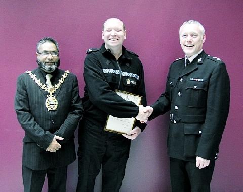 COMMENDED  PC Dave Mullen with Chief Super Bob Eastwood, right, and Mayor of Blackburn Coun Zamir Khan