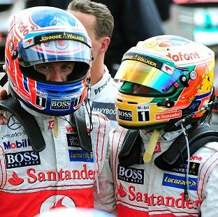 Jenson Button, left, and Lewis Hamilton were fastest in first practice for the Australian Grand Prix