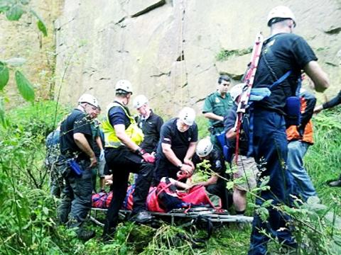 PLUNGE Rescuers help the victim before he is taken to hospital