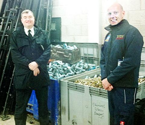ECO FUTURE Insp Steve Bradshaw with Geoff Astle of Wirral Metals, which is recycling the used ammunition cases