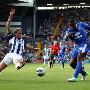 Jonas Olsson blocks a shot by Everton's Victor Anichebe