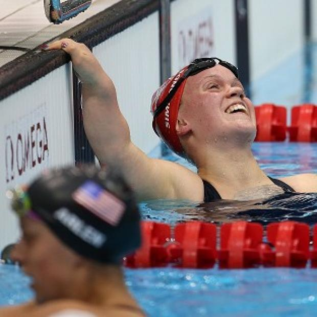 Ellie Simmonds celebrates her victory in the 400m freestyle S6 final ahead of American Victoria Arlen, below