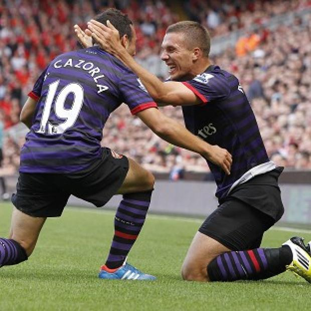 Blackpool Citizen: Lukas Podolski, right, celebrates his first Arsenal goal with Santi Cazorla, who also netted
