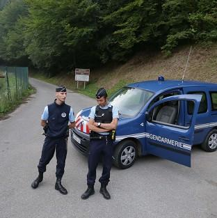 Gendarmes block access to the site of the shooting near Cheval