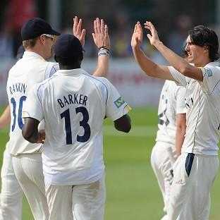 Warwickshire's Chris Wright, right, celebrates taking the wicket of Worcestershire's Joe Leach