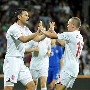 Blackpool Citizen: Frank Lampard, left, celebrates scoring England's first goal with Tom Cleverley