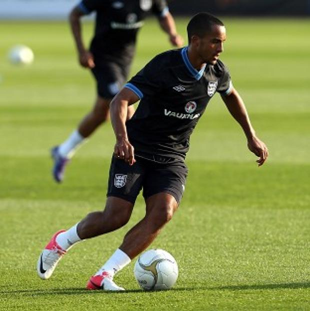 Blackpool Citizen: Theo Walcott, pictured, and Daniel Sturridge missed training through illness