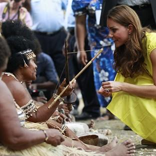 The Duchess of Cambridge talks to a woman in traditional outfit in Honiara, Solomon Islands (AP/Daniel Munoz)