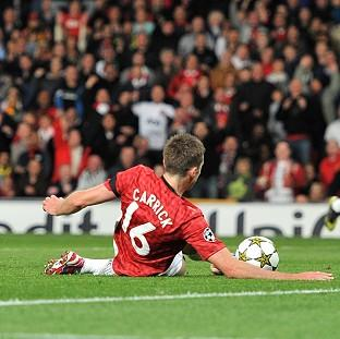 Michael Carrick slides United into the lead