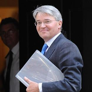 Andrew Mitchell has apologised after exchanging words with police on Downing Street