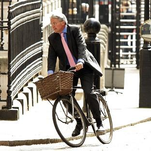 Andrew Mitchell exchanged words with police on Downing Street when he tried to leave on his bicycle