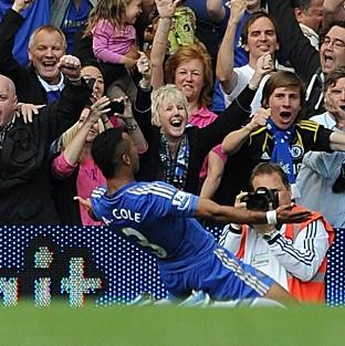Ashley Cole slides on his knee after netting the winner late on