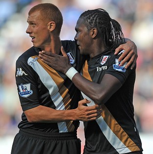 Fulham's Hugo Rodallega is congratulated on scoring his team's first goal by team-mate Steve Sidwell at Wigan