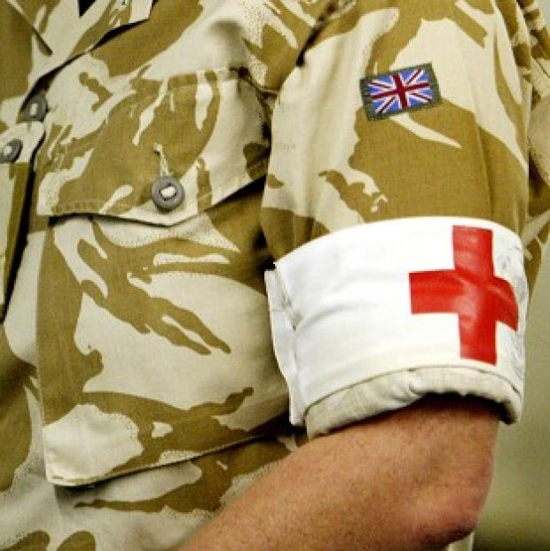 A British servicewoman who gave birth in Afghanistan is believed to be at the John Radcliffe Hospital in Oxford