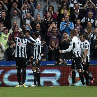 Demba Ba, left, celebrates scoring the winner