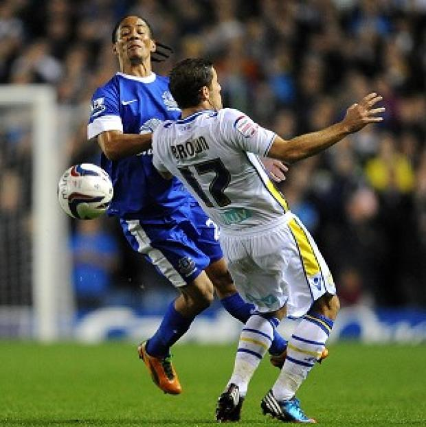 Blackpool Citizen: Steven Pienaar, left, and Michael Brown tussle in Leeds and Everton's Capital One Cup match