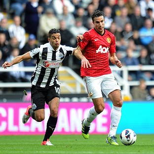 Robin van Persie, right, and Hatem Ben Arfa battle for the ball in a full-blooded Tyneside clash