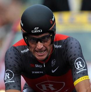Tyler Hamilton is one of Lance Armstrong's, pictured, former US Postal Ser