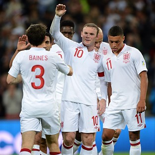 England's Wayne Rooney, centre, celebrates scoring his second and his side's third goal