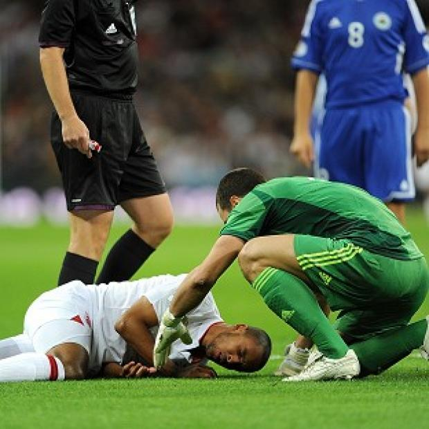 Theo Walcott, left, was injured after San Marino goalkeeper Aldo Simoncini's rash challenge