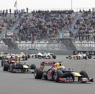 Sebastian Vettel, right, is the new leader in the driver's championship (AP Photo/Lee Jin-man)