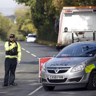 Police at a cordon on Pinfold Lane in Alltami, after a burned-out car which matched the description of Catherine Gowing's vehicle, was found