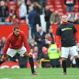 Rio Ferdinand, left, did not wear a Kick It Out anti-racism campaign t-shirt during the warm up