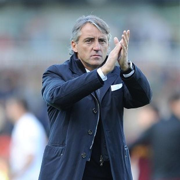 Txiki Begiristain will be supporting City boss Roberto Mancini, pictured, in recruitment