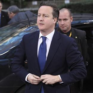 David Cameron arrives for the EU summit in Brussels (AP)