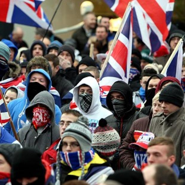 Loyalists in Belfast city centre protest against new restrictions on flying the Union flag