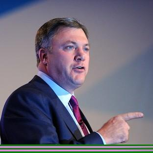 Shadow chancellor Ed Balls says people out of work for a minimum of two years should get a guaranteed job