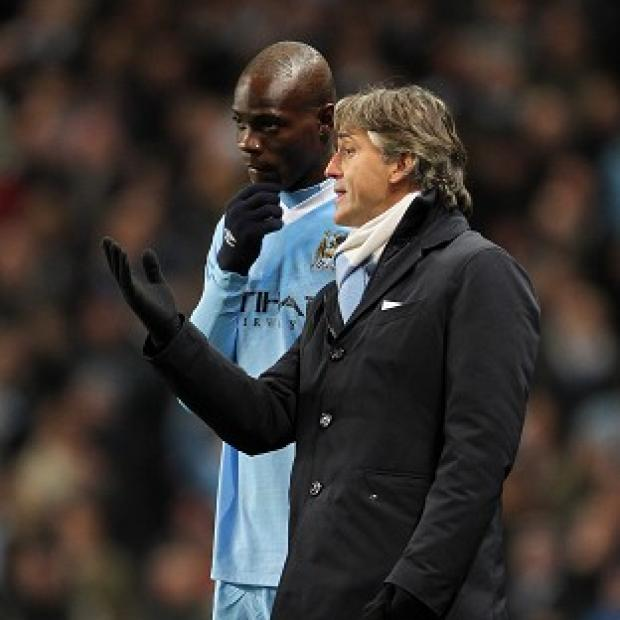 Roberto Mancini, right, insists 'there was no fight' with his striker Mario Balotelli, left