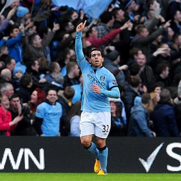 Carlos Tevez netted Manchester City's opener against Watford