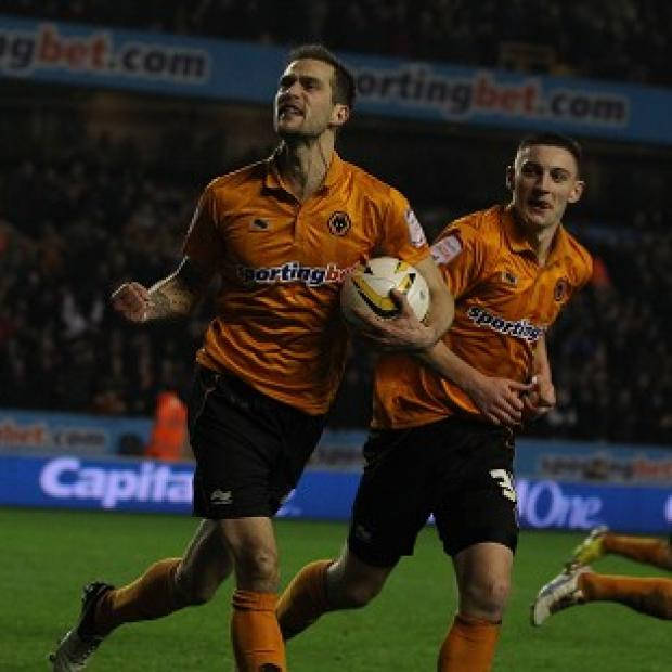 Roger Johnson, left, celebrates scoring the equaliser for Wolves against Blackburn Rovers