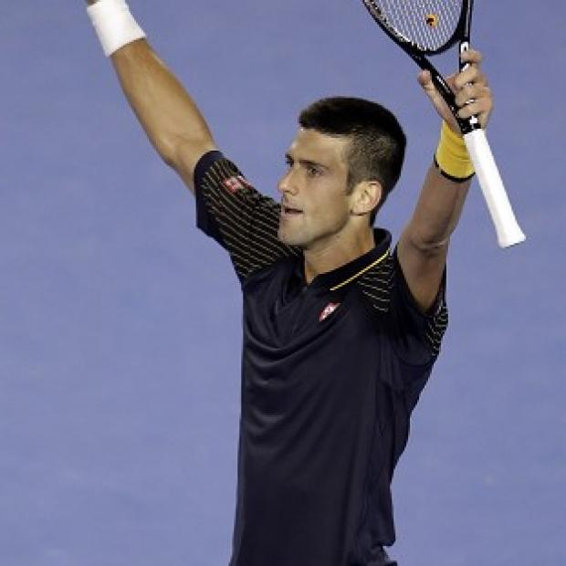 Novak Djokovic, pictured, took over five hours to defeat Stanislas Wawrinka at the Australian Open (AP)