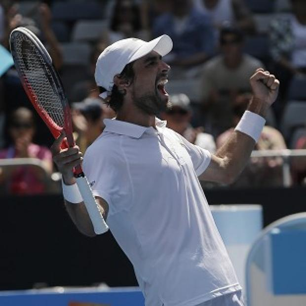 Jeremy Chardy celebrates after winning his fourth round match at the Australian Open (AP/Rob Griffith)