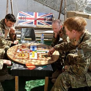 Prince Harry, or Captain Wales as he is known in the British Army, playing a game of Uckers in the VHR tent