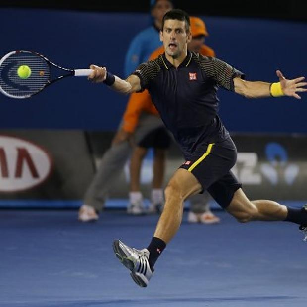 Novak Djokovic makes a forehand return during the Australian Open final (AP)