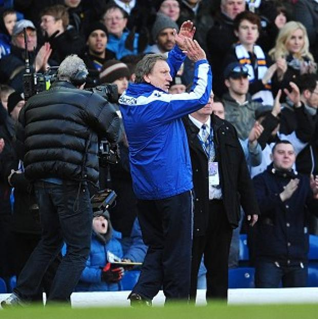Leeds United manager Neil Warnock appluads home fans after the final whistle