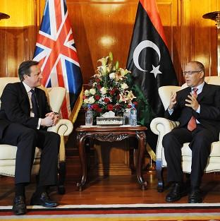 David Cameron meets Libyan Prime Minister Ali Zeidan during his visit to the country