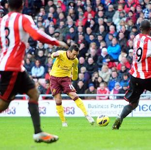 Santi Cazorla crashed home as Arsenal beat Sunderland