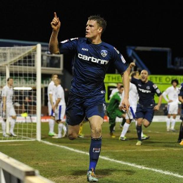 Matt Smith celebrates scoring Oldham's equaliser against Everton