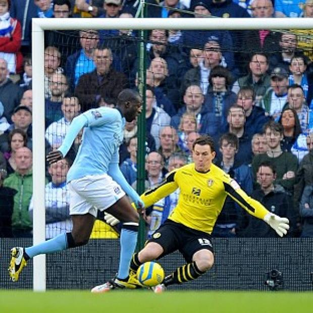 Yaya Toure, left, scores Manchester City's opening goal against Leeds United