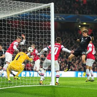 Thomas Muller, right, was on target with Bayern Munich's second goal in the victory over Arsenal