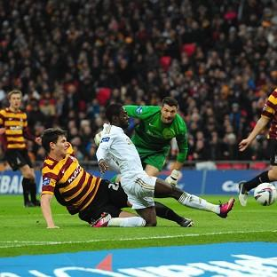 Nathan Dyer, second from left, scores Swansea's first goal of the final against Bradford
